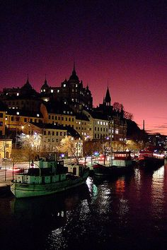 https://flic.kr/p/4th66L | Stockholm by night | Stockholm by Night, sunset  Surreal. The light made me think the scene was in some sort of a fairytale. This is the southcentral part of Stockholm called Södermalm.  A pittoresk part with lots of old houses. The former quarters of the workers. Later it became a cultural hotspot when lots of artists were able to rent cheap studios. Nowadays it's pretty expensive to hire in this part and middleclass citizens are taking over.  Söder Mälarstrand…