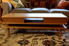 Cherry coffee table. Mid century modern is so cool.
