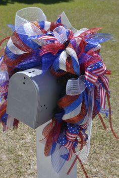Patriotic mailbox swag/ wrap. Red, white and blue striped deco mesh. Pine mailbox swag, deco mesh ribbon, flex tubing, ribbons in the American flag design.