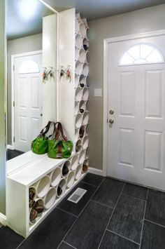 PVC pipe repurposed into shoe organization. Easy to wipe clean as opposed to traditional cloth hanging shoe organizer