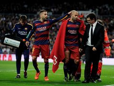 Javier Mascherano of FC Barcelona comes off injured during the La Liga match between Real Madrid and Barcelona at Estadio Santiago Bernabeu on November 21, 2015 in Madrid, Spain.