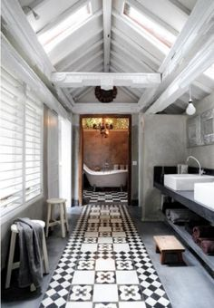 Love the look of this bath- great tile pattern, skylights and would prefer a shower room at the end flooded with light- guest or master bath look and feel