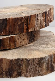 "Round Natural Wood Tree Slabs 12-14"" wide $20.  This website has LOTS of stuff at bulk price."