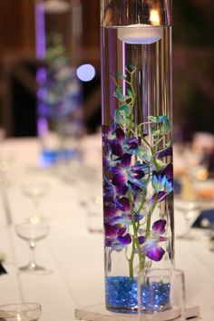 Blue and Purple orchids reception wedding flowers,  wedding decor, wedding flower centerpiece, wedding flower arrangement, add pic source on comment and we will update it. www.myfloweraffair.com can create this beautiful wedding flower look.