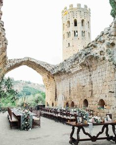This Romantic Italian Wedding Features a Historic Venue—and One Amazing View | Martha Stewart Weddings - Everyone moved to the other side of the church for the al fresco reception, complete with views of the 12-sided tower on site, the Orvieto Duomo and surrounding Tuscan countryside. Two long tables were set in the courtyard as well as a table of family wedding photos to honor the generations and those that couldn't be there to celebration with Amanda and Pat.