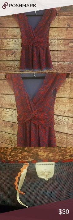Anthro ric rac flower top size small Anthropologie Ric Rac red flower blouse size small in great condition. Have the same one in blue in my posh closet  B84  *Suggested user ∆ Open to all offers ∆ Bundle and save or bundle and make me an offer! ∆ Shipped next day if ordered before 8pm PST ∆ Anthropologie Tops Blouses
