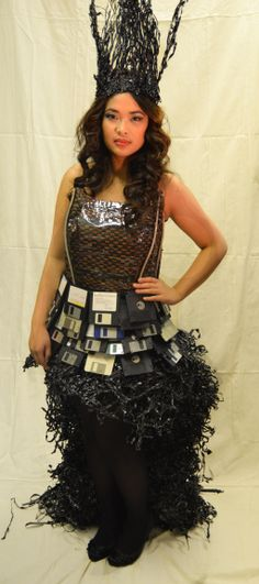Junk Kouture dress made from weaved and melted video and cassette tape, floppy disks and wire.