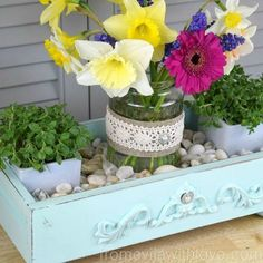 diy spring centerpiece made from an old drawer and pickle jar
