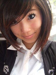 Hair: inverted bob, side bangs, dark hair, short. Slightly creepy eyelashes.