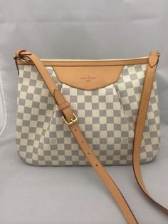 Louis Vuitton Siracusa Mm Damier Azur Cross Body Bag. Get the trendiest Cross Body Bag of the season! The Louis Vuitton Siracusa Mm Damier Azur Cross Body Bag is a top 10 member favorite on Tradesy. Save on yours before they are sold out!
