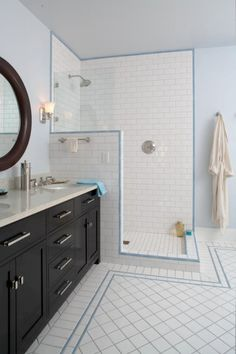 by Sarah Henry by Sarah Henry Another great reason to take tile higher: You can mount your shower fixture higher, which can be a necessity if someone in your household is tall.