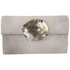 YSL Yves Saint Laurent Vintage Haute Couture Crocodile Clutch Bag  | From a collection of rare vintage clutches at https://www.1stdibs.com/fashion/handbags-purses-bags/clutches/