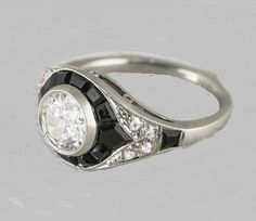 Hey, I found this really awesome Etsy listing at https://www.etsy.com/listing/176908973/art-deco-engagement-ring-117ct-certified