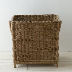 "Woven rattan welcomes large-scale house plants or makes for convenient storage in this footed basket, with sturdy, long-lasting construction thanks to metal supports.- Rattan, metal- Indoor use only- Imported18""H, 18.5""W, 18.5""L, 16""D"