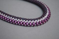 bead crochet necklace with superduo as one of the beads - then join the outer holes of the superduo - inaurem