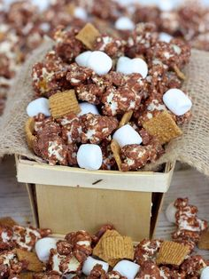 S'mores Popcorn. Mix in chocolate chips with hot popped popcorn; add Golden Grahams cereal and mini marshmallows. 1 (3 ounce) bag microwave popcorn, popped, 8 ounces chocolate candy coating, melted, 2 tablespoons graham cracker crumbs, 1-1/4 cups mini marshmallows, 1-1/4 cups Golden Grahams cereal