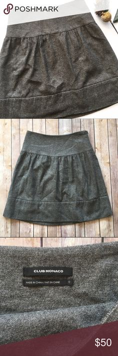"""Club Monaco Shimmer Gray Metallic Wool Blend Skirt Beautiful shimmery gray metallic and wool blend skirt, perfect for winter and the holidays! 77% wool, 17% nylon, 6% metallic. Lined (lining is 100% acetate). Side zip and hook closure. Waist masures approx. 13.5"""" across. Approx. 19"""" L. Excellent pre-loved condition!   🚫no trades 🚫no modeling ✅dog friendly/🚭smoke free home ✅reasonable offers ✅bundle & save! Club Monaco Skirts"""
