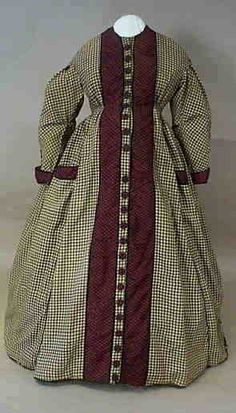 Maternity Dress, circa 1865, United States. Materials: Cotton flannel gingham, silk gingham, velvet ribbon, steel hook and eyes, cotton twill lining (skirt), cotton flour sacks lining (bodice). Label: Part of printing on flour sack lining reads: Love. Wheat. Flour. Creek, PA. Miller.