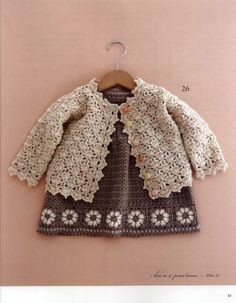 Pretty knitted baby girl's dress and cardigan