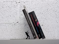 Oh no! Falling books! Don't let them squish you but do let them capture your heart. We have these bookends in our gift section.