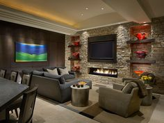 fire place & TV, rustic earthy stone surround