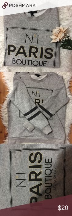 Grey Paris Sweatshirt Worn maybe once or twice. No pilling or stains. No rips either 😊 great condition. If you have any questions please ask!! Size M forever 21 brand Forever 21 Tops Sweatshirts & Hoodies