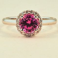 18K White Gold Sapphire Halo Diamond Ring. Set with a 6mm Round Pink Sri Lanka Sapphire. #BrilliantEarth