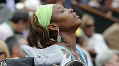 Serena Williams looks up to the sky during a 2010 tournament