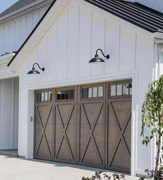 Beautiful garage door and stain color.