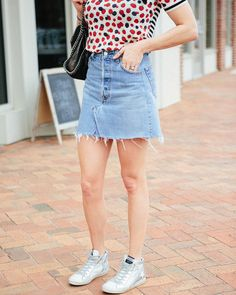 J.Crew berry knit shirt // Levi's ReDone denim skirt // Golden Goose sparkle high tops // Blogger Lindsey Lutz details her top 5 denim skirts under $100