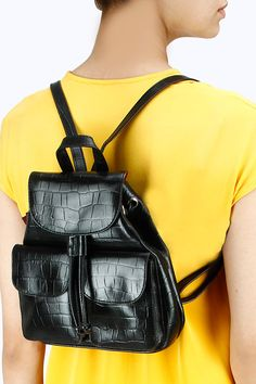 Black leather two pocket small backpack BY SANYA V JAIN. Shop now at perniaspopupshop.com #perniaspopupshop #accessory #amazing #elegant #exquisite #shopnow #musthave