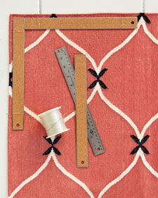 Is your rug tripping you up? Keep cotton flat-weave and other lightweight rugs from slipping around and curling with this tried-and-true trick: Attach a pair of flat, cork-backed rulers along the edges of each corner. Using a large, heavy-duty needle and monofilament, stitch through the rug, and tie it around the ruler in a couple of spots to secure.