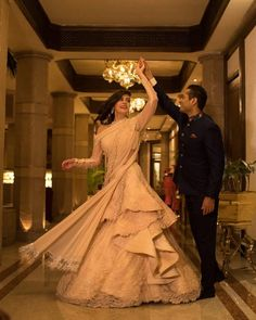 Our Favourite Brides in Glamorous Wedding Outfits by Gaurav Gupta A lacy ruffled lehenga teamed with a sultry blouse and a tasseled drape Indian Wedding Gowns, Indian Gowns Dresses, Indian Bridal Outfits, Evening Dresses, Bride Reception Dresses, Bridal Dresses, Wedding Dress, Lehenga Gown, Bridal Lehenga