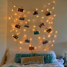Clip photos on a string of Christmas lights