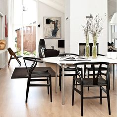 Image result for black wishbone chair white table