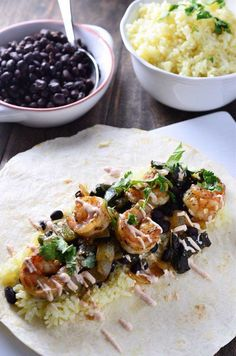 This shrimp & roasted poblano burrito is loaded with shrimp, poblano peppers, garlic rice, black beans and a creamy chipotle sauce. Chipotle Sauce, Quick Meals To Make, Stuffed Poblano Peppers, Burritos, Black Beans, Risotto, Shrimp, Ethnic Recipes, Food