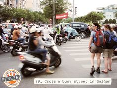 Crossing the street in Vietnam - walk at a steady pace & the traffic will go around you!  It is SCARY!