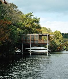 Further West, architect Arthur Andersson along with his partner Chris Wise, designed this prefab boathouse in Austin, Texas. Photo by Pau...