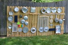"""The idea is to find household items, percussiveinstruments(or pieces of former instruments), or anything that would make a pleasing or interesting sound when rubbed, struck or plucked, attach it to a """"wall"""", and let the kids have at it!"""