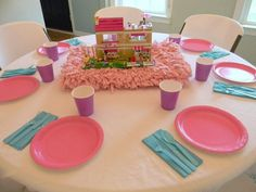 I love the simplicity of the table settings. You could use a new lego set (gift) as the centerpiece too