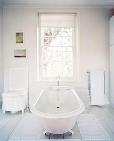 Bathroom Photo - A freestanding claw-foot tub in a white bathroom
