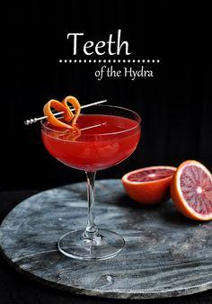 teeth of the hydra | rye (I used Templeton), Campari, blood orange juice, lemon juice, pomegranate molasses, rosewater, Blood orange peel, for garnish