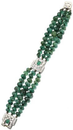 Emerald and diamond bracelet, Lacloche Frères, circa 1930. Composed of three graduated rows of emerald beads, highlighted with geometric patterns set with square-cut emeralds within baguette and single-cut diamonds, length approximately 175mm, signed Lacloche Frères. Via Sotheby's.