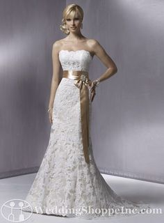 I am absolutely obsessed with lace wedding gowns, and I LOVE the sash and brooch on this one!