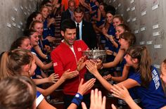 ♔Champion Novak Djokovic of Serbia celebrates with the ball girls following his victory during the Men's Singles final match against Andy Murray of Great Britain on day fifteen of the 2016 French Open at Roland Garros on June 5, 2016 in Paris, France