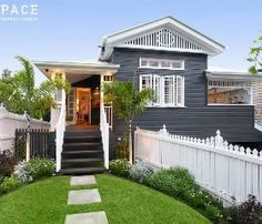 Dark grey (or blue??) weatherboards, white accents. Like it a lot. Need to have enough white, though.