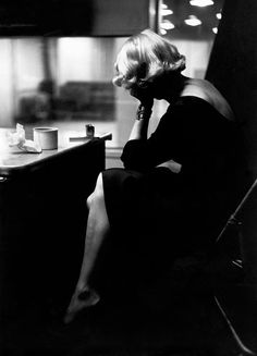 Eve Arnold. USA. New York City. Marlene DIETRICH at the recording studios of COLUMBIA RECORDS, who were releasing most of her songs she had performed for the troops during World War II, including LILI MARLENE, Miss Otis Regrets.She was 51 years old and starting a come-back in show business.It was a wet and cold November night and work could only begin at midnight, at the advise of Marlene's astrologer. November 1952.