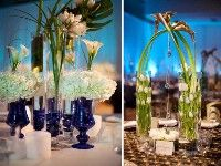 tulips in tall vases, the calla lilies are arched over the top and some glass pieces are attached between the calla lilies.  Creative!
