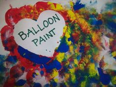 Fill balloons with paint, blow them up a little, tie them and stick them to a canvas.. Finally get darts to throw at the balloons.  In the spot that is blocked off so paint doesn't get on it write the resident's names and use it as a bulletin board or hallway artwork for the floor