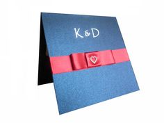 Beautiful Kings Blue card with a red satin ribbon and mini diamante heart invitation. The couples initials here were foiled in silver. Colours can be changed to suit. www.lilguy.co.uk